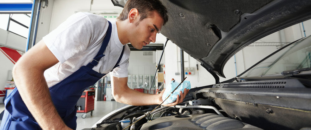 Mechanic doing Vehicle preventive Maitenance