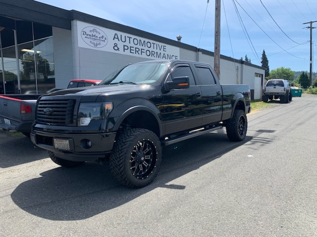 Ford with a back flip bed cover and 6″ lift kit